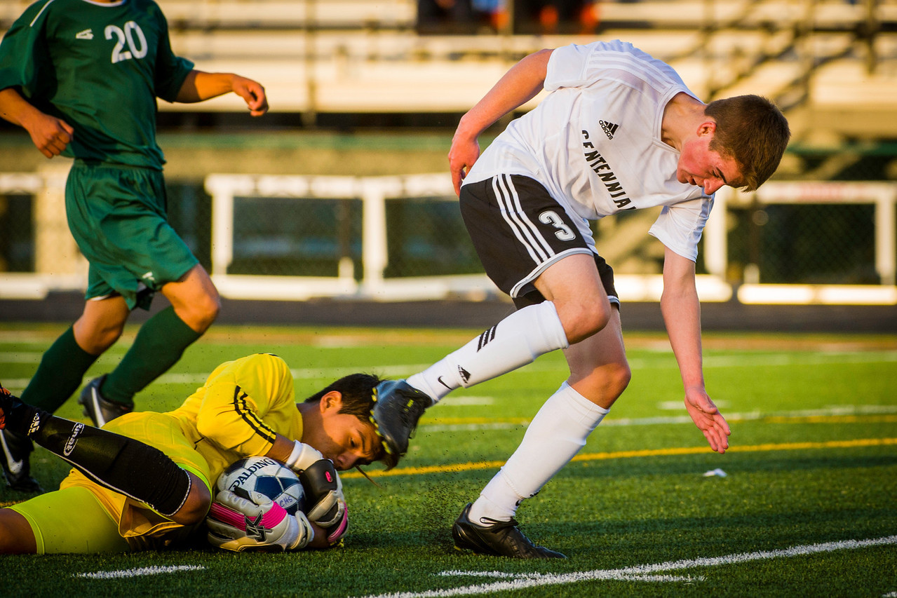 Dallas Smith (3), Sophmore, Midfielder, is foiled on a scoring attempt during the first half of the Ankeny Centennial High School Boys Varsity Soccer Team versus North High School game.